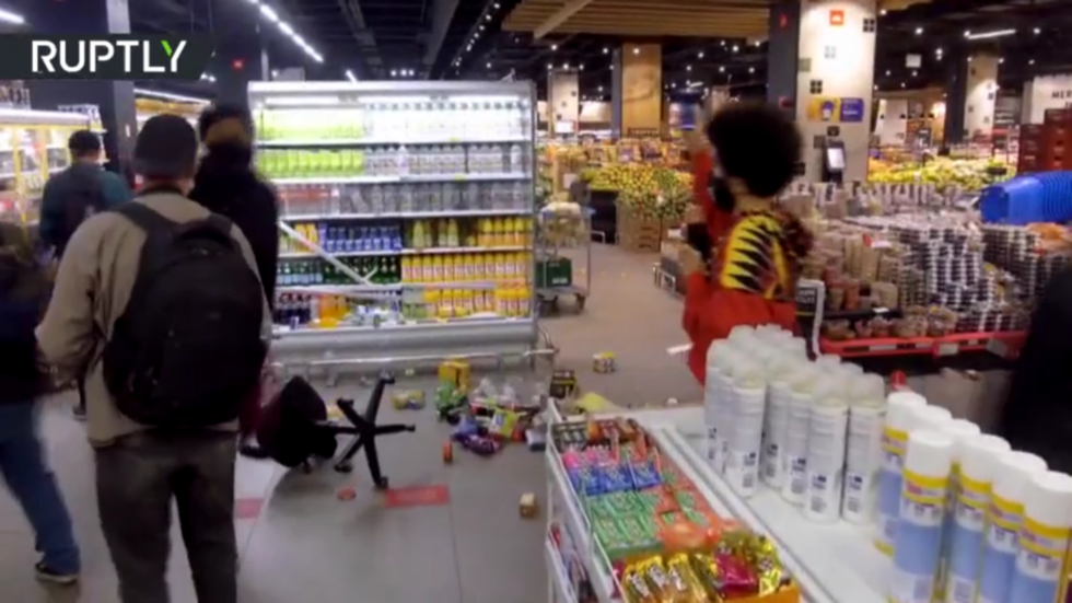 Rioters storm Brazilian supermarket & set FIRES after security guards allegedly kill black man (VIDEO)